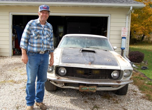John Grafelman proudly stands by his historic Mustang