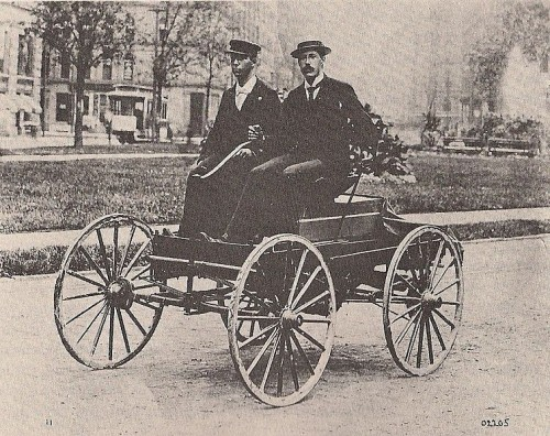 Charles Brady King (r) and an assistant on the streets of Detroit in King's motor car